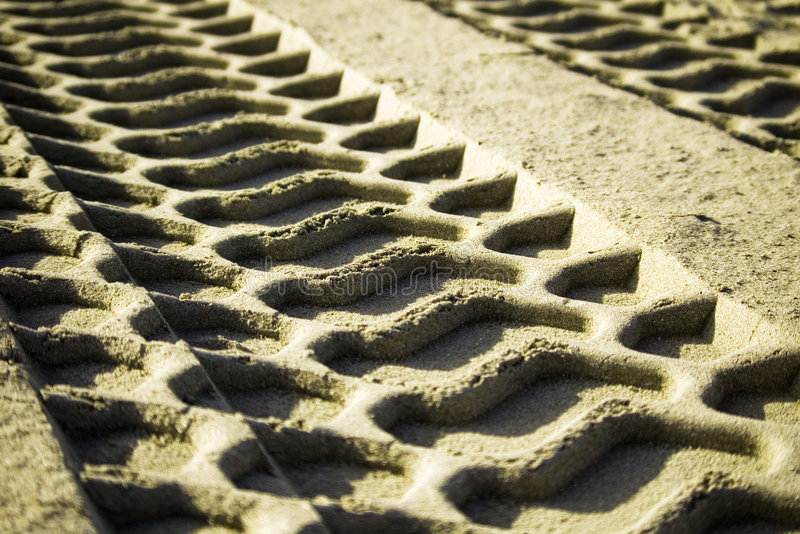 Tire track in the sand royalty free stock images