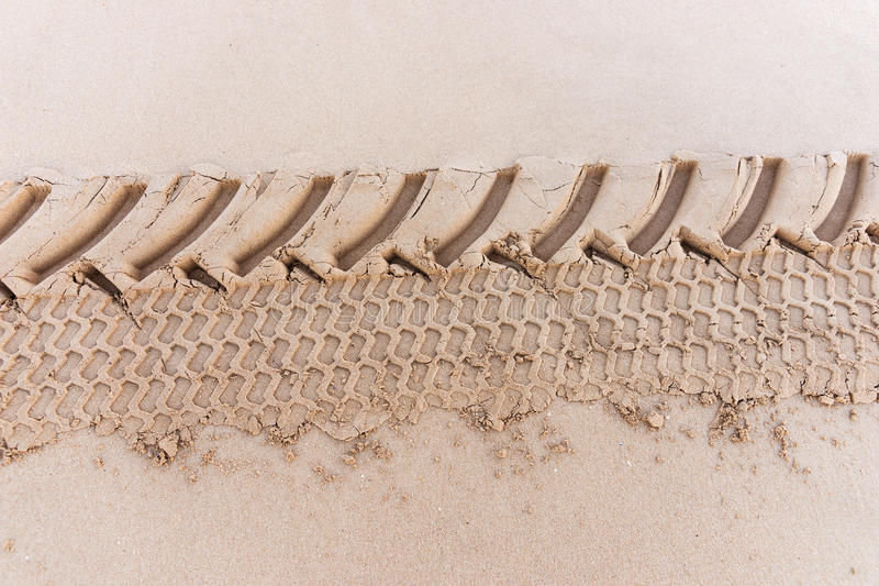 Tire track in the sand royalty free stock photography