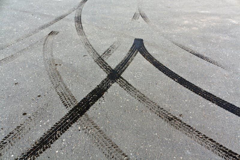 Tire tracks on asphalt. stock image