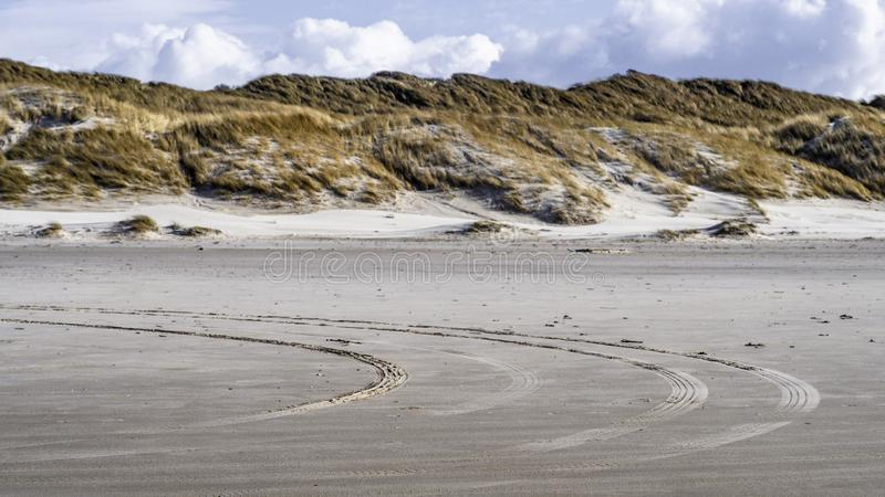 Tire Tracks on the beach in Løkken, North Denmark stock photography