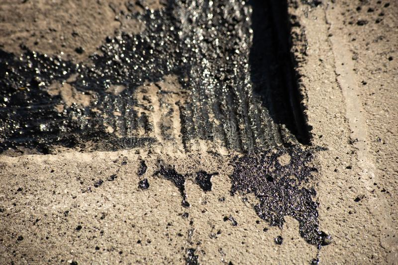 Tire tracks on bitumen on the surface of asphalt under construction stock images