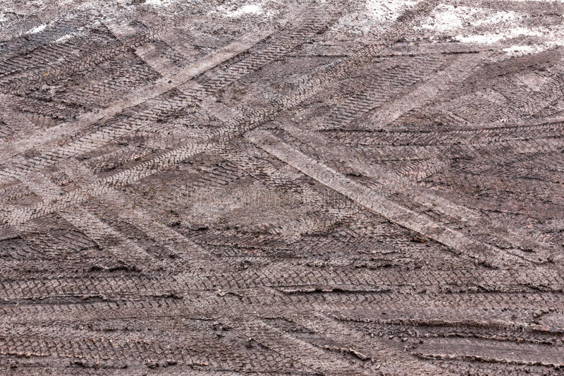 Tire tracks in the mud royalty free stock photo