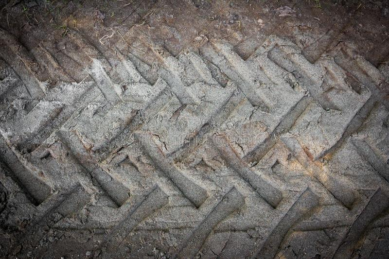 Tire tracks on a muddy road stock photography