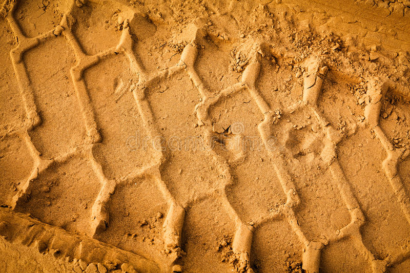 Tire tracks on the sand royalty free stock image