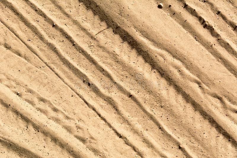 Tire tracks on the sand royalty free stock images