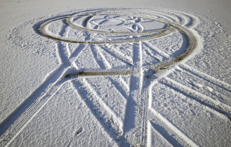Tire tracks in snow stock photo