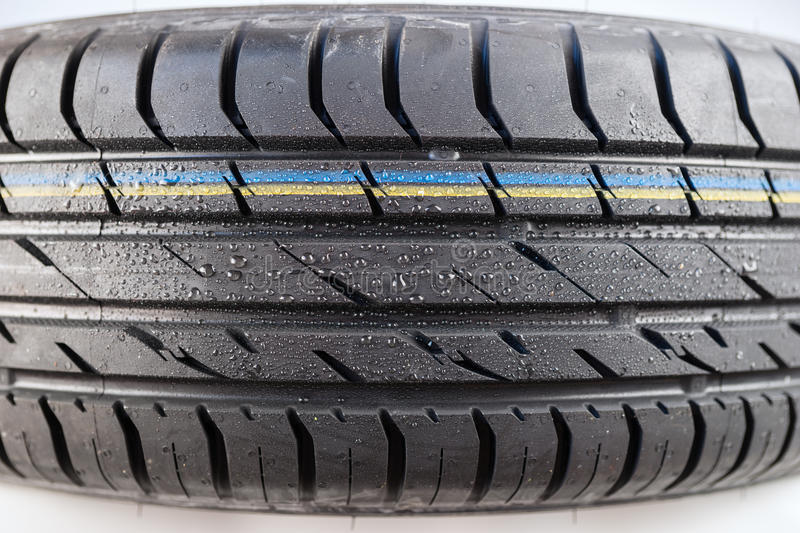 Tire tread in wet weather condition stock photo