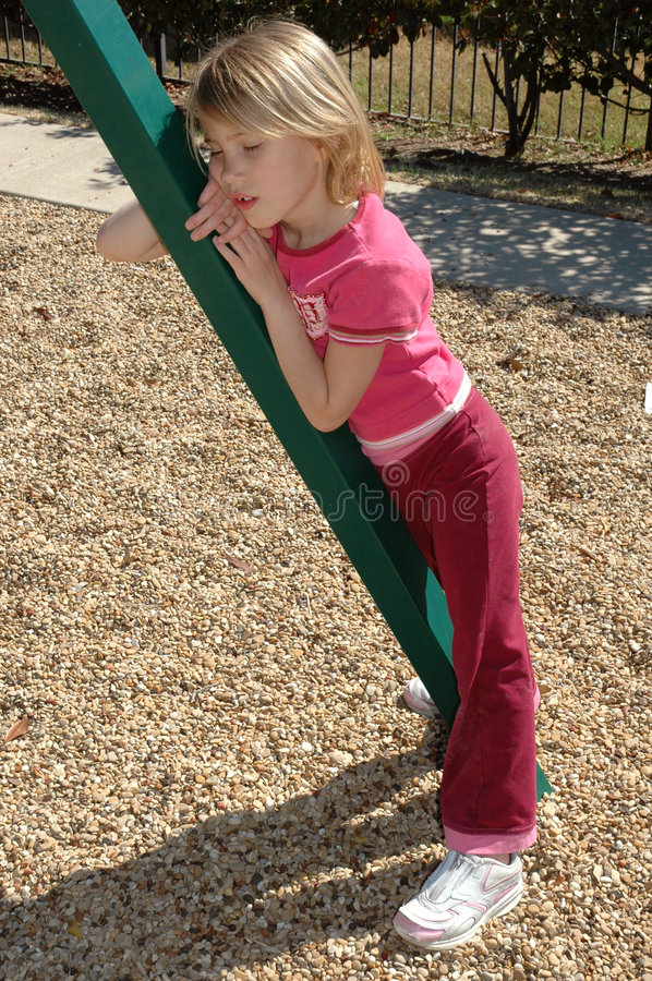 So Tired. Little girl is fatigued and tired from waiting her turn at the park. Played herself out royalty free stock photography