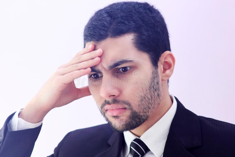 Tired arab business man with headache royalty free stock photos