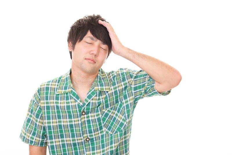 Tired Asian man stock photo