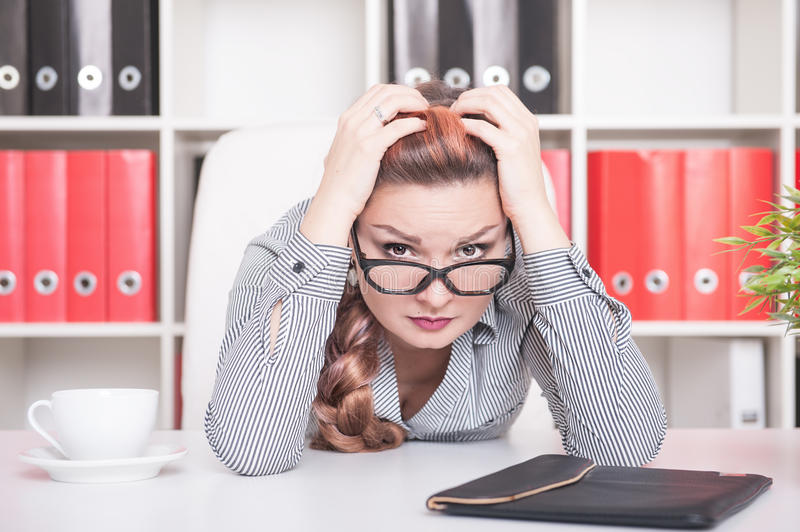 Tired beautiful business woman working in office royalty free stock images