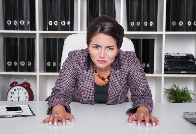 Tired bored business woman working in office stock image