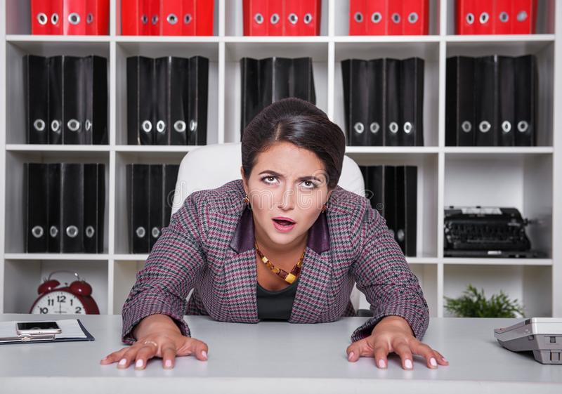 Tired bored business woman working in office royalty free stock photos
