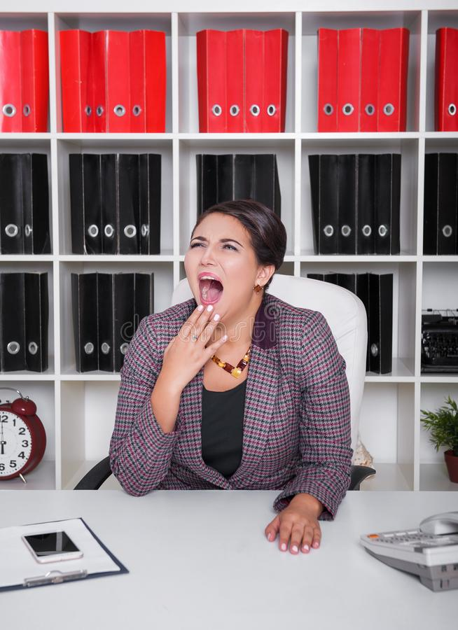 Tired bored business woman yawning. Overwork concept stock photography