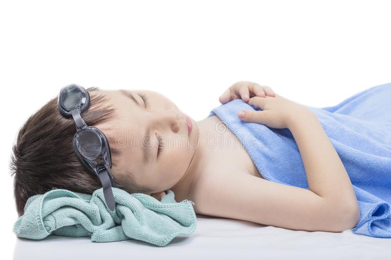 A tired boy sleeps after playing in the pool. royalty free stock photo