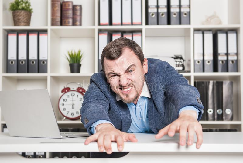 Tired business man working in office. Overwork concept stock photo
