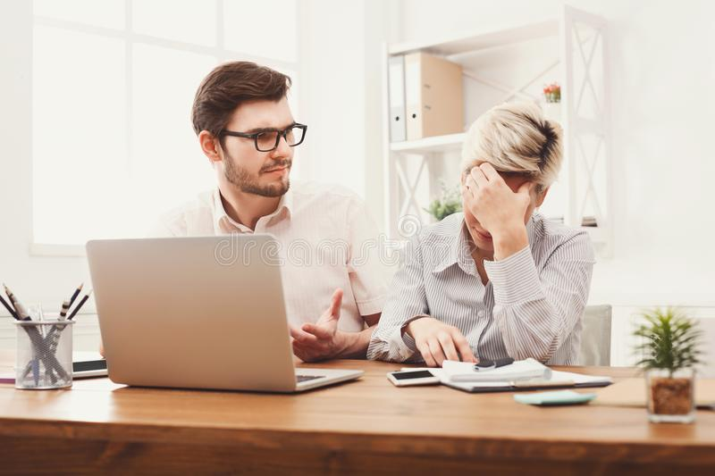 Tired business partners in modern office royalty free stock photo