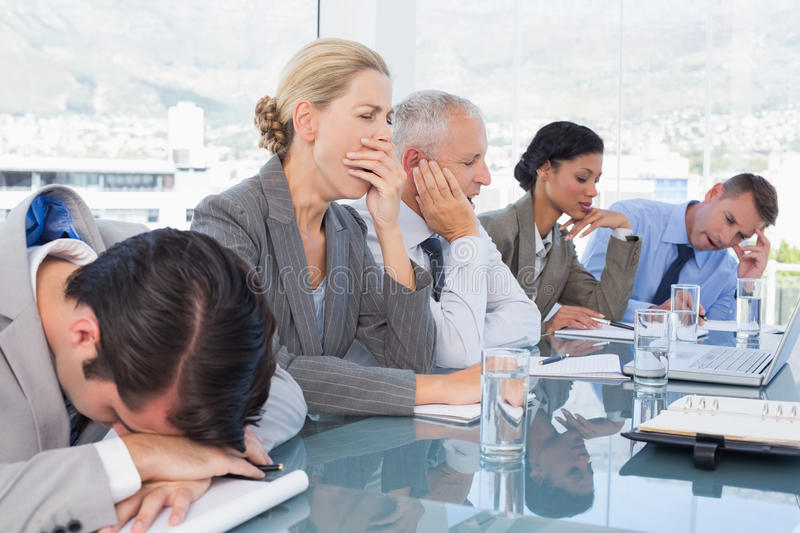 Tired business team at conference stock photo
