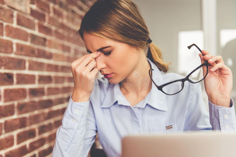 Tired business woman royalty free stock image