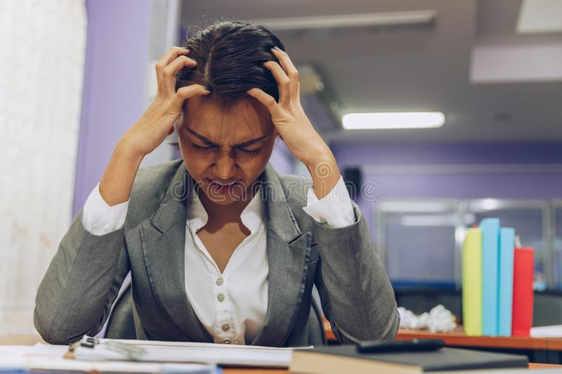 Tired business woman with headache at office, feeling sick while working stock image