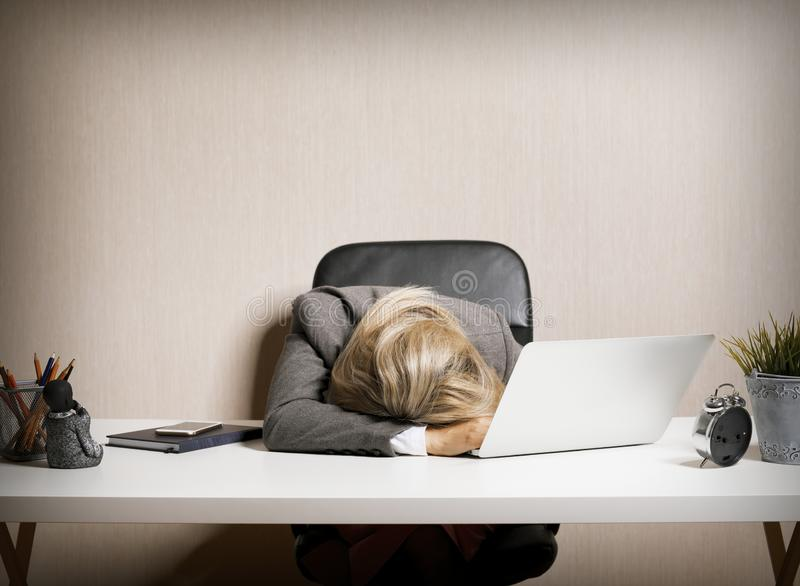 Tired business  woman sleeping on laptop royalty free stock photography