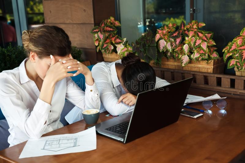 Tired business women having headache at office. Hard work royalty free stock photos