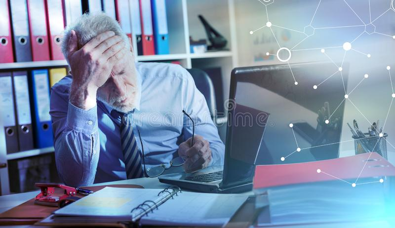Tired businessman with headache, light effect; multiple exposure stock photos