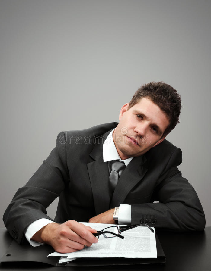 Tired businessman at his office stock photo