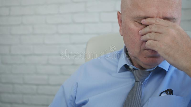 Tired Businessman Image at Workplace in Company Office royalty free stock photos