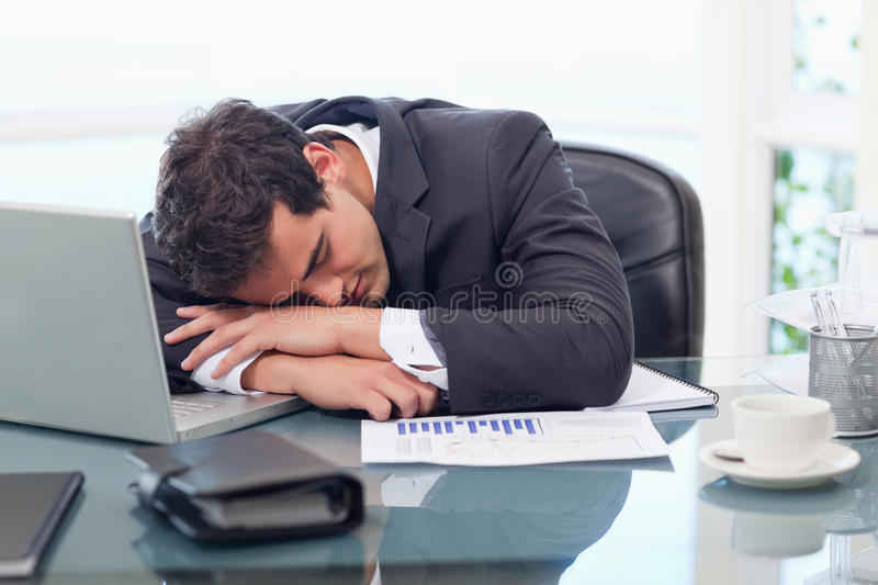 Tired businessman sleeping. In his office royalty free stock photo