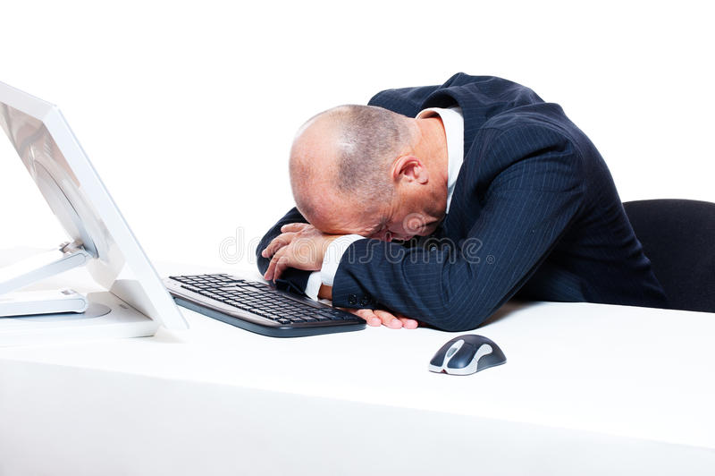 Tired businessman sleeping on his workplace. Over white background stock photo