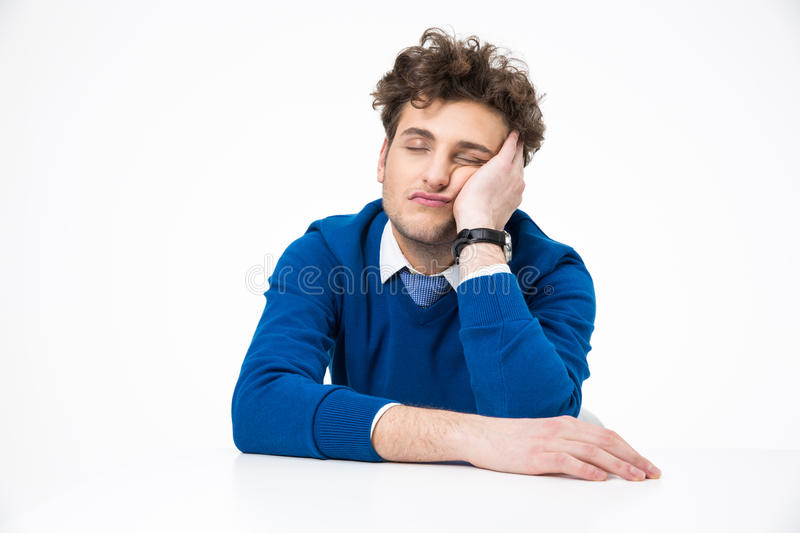 Tired businessman sleeping at the table. Over white background stock images