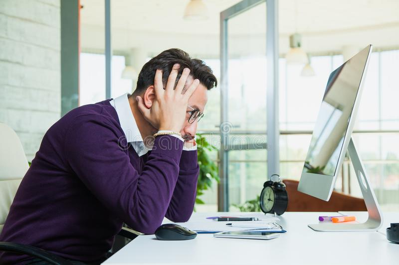 Tired businessman student hold his head. royalty free stock photo