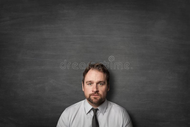 Tired businessman with tie stock photo