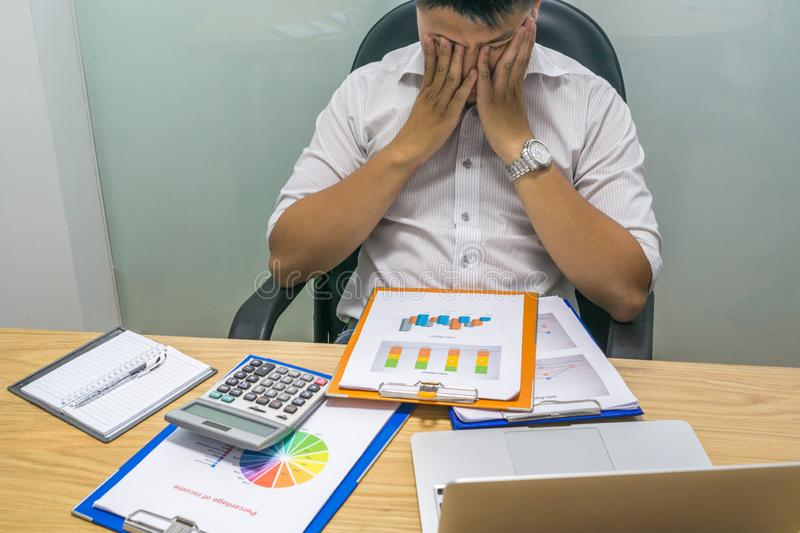 Tired businessman worry about the financial problem royalty free stock photo