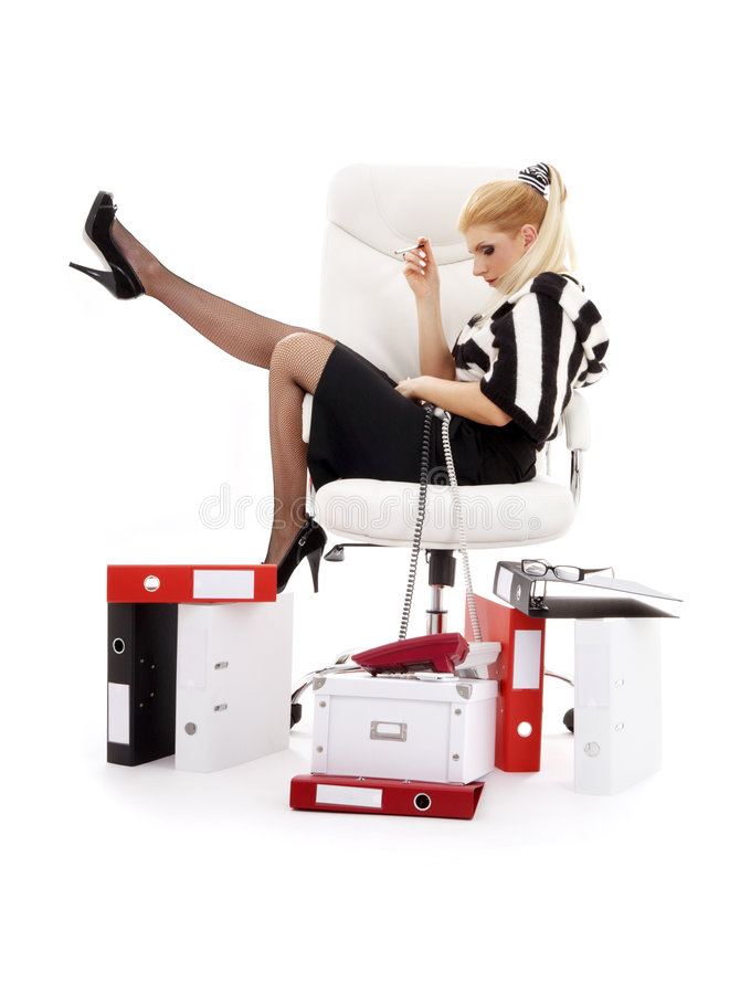 Tired businesswoman in chair over white royalty free stock photo