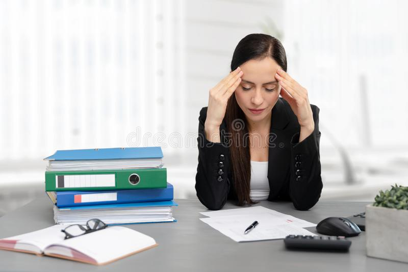 Tired businesswoman in the office royalty free stock photography