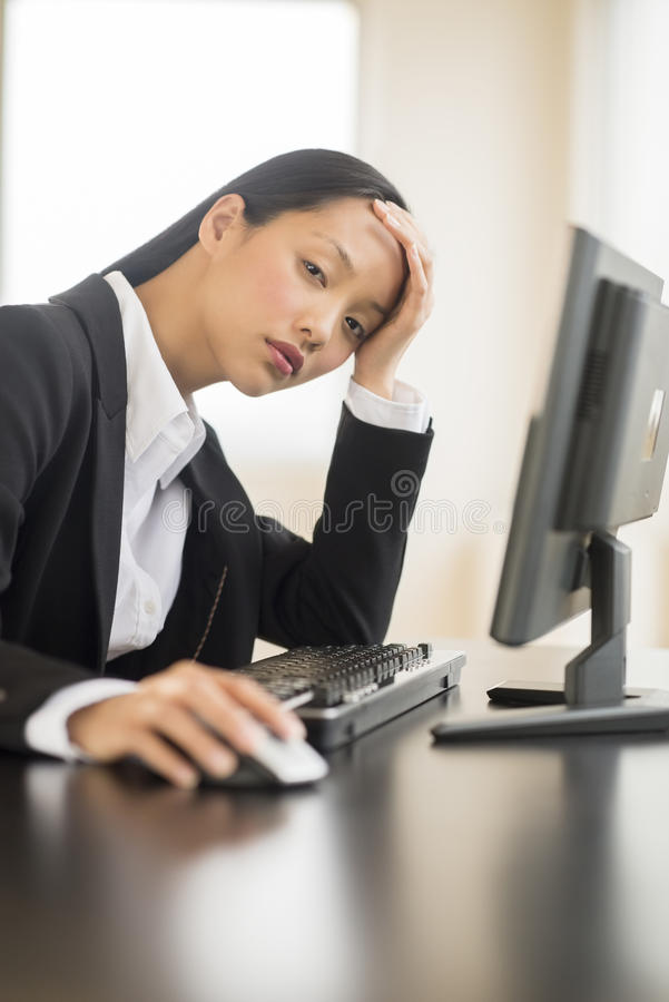 Download Tired Businesswoman Using Computer At Desk Stock Image - Image of looking, businesswomen: 32278665