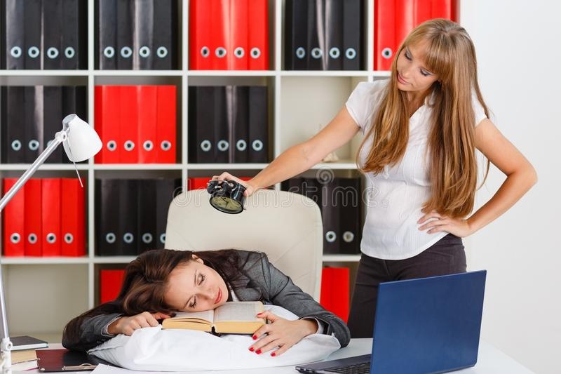 Tired businesswomen in the office. stock photos