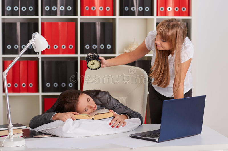 Tired businesswomen in the office. royalty free stock image