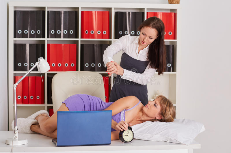 Tired businesswomen in the office. stock images