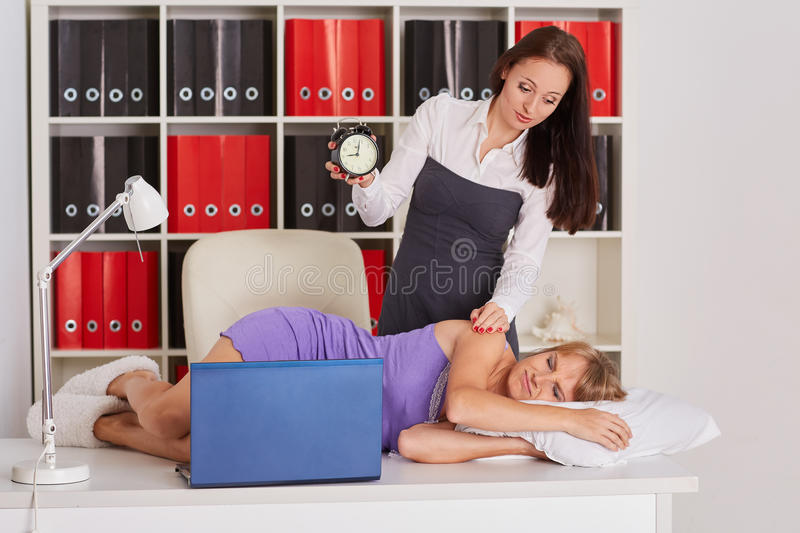Tired businesswomen in the office. stock photo