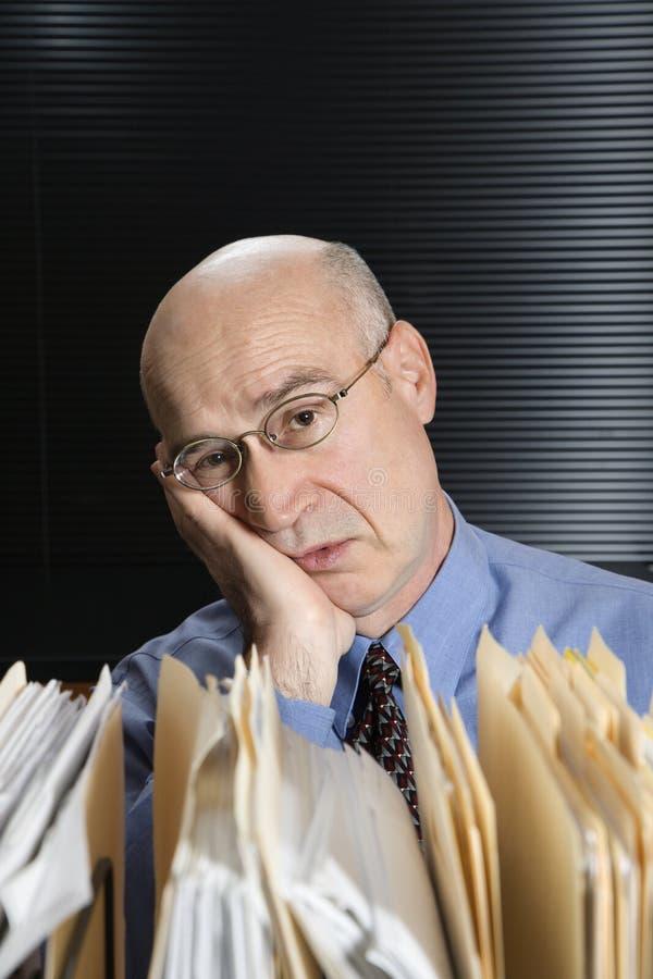 Tired Caucasian businessman. stock images