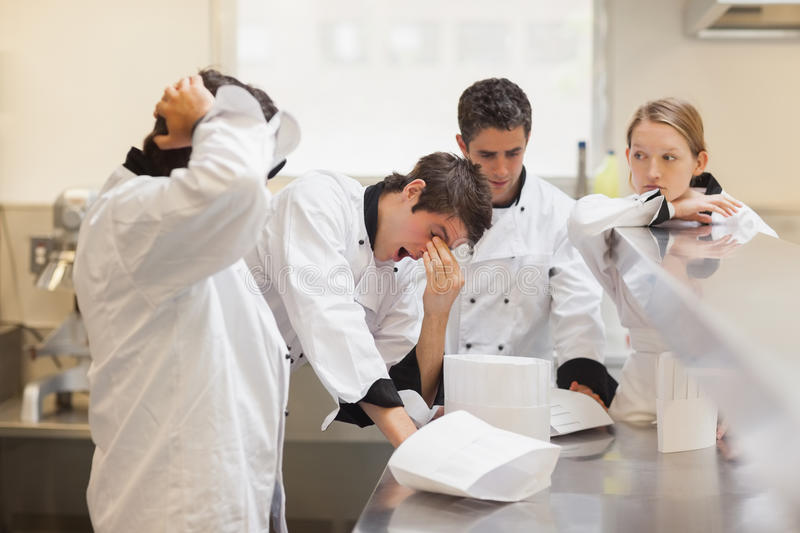 Tired chefs team waiting. In the kitchen royalty free stock photos