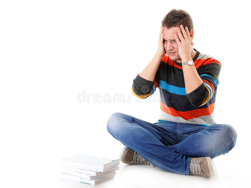 Tired college student with stack of books isolated royalty free stock photo