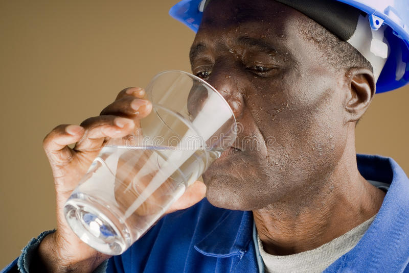Tired Construction Worker. Drinking Water royalty free stock image