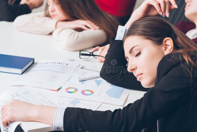 Tired corporate manager sleep desk overworking. Tired corporate managers. Overworking concept. Business team members sleeping on desk royalty free stock photos