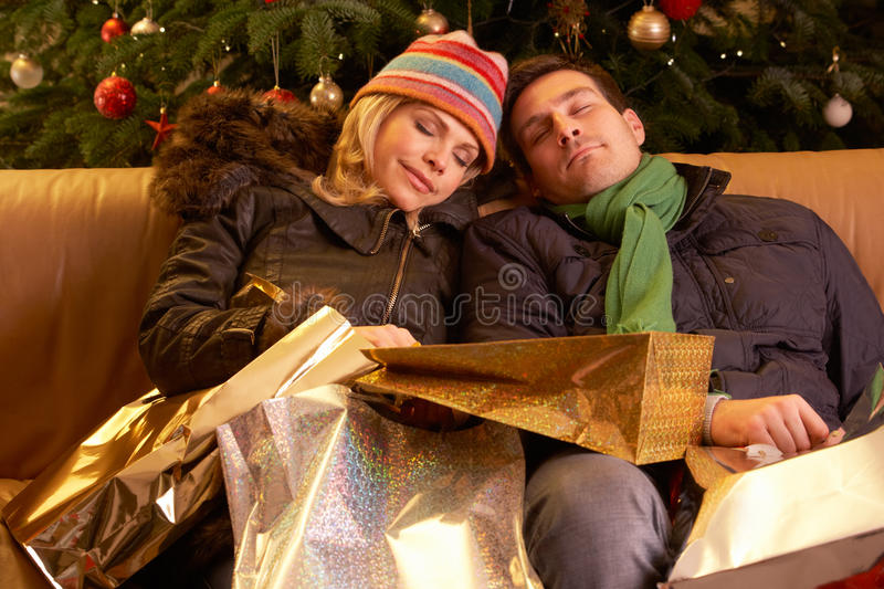 Tired Couple Returning After Christmas Shopping. Trip royalty free stock photo