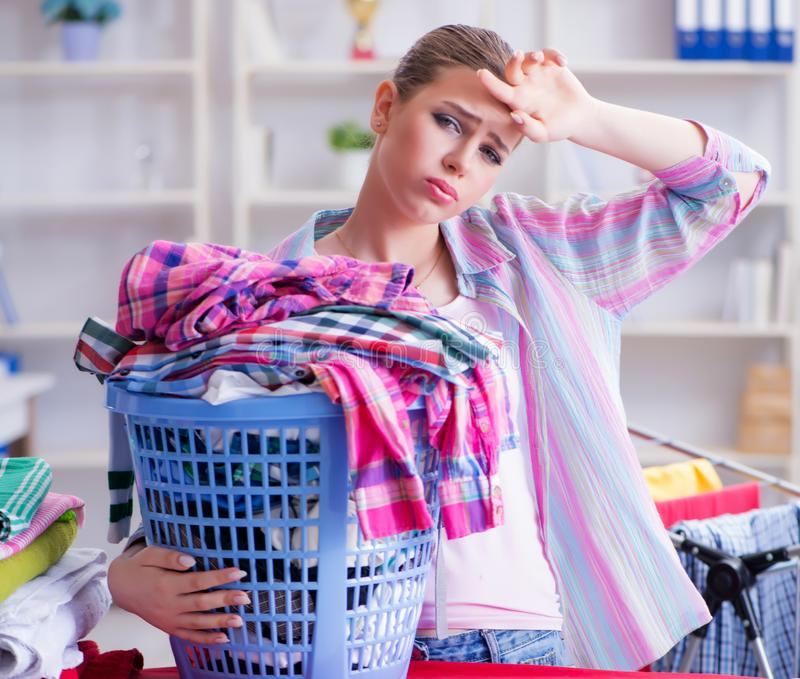 Tired depressed housewife doing laundry royalty free stock photos
