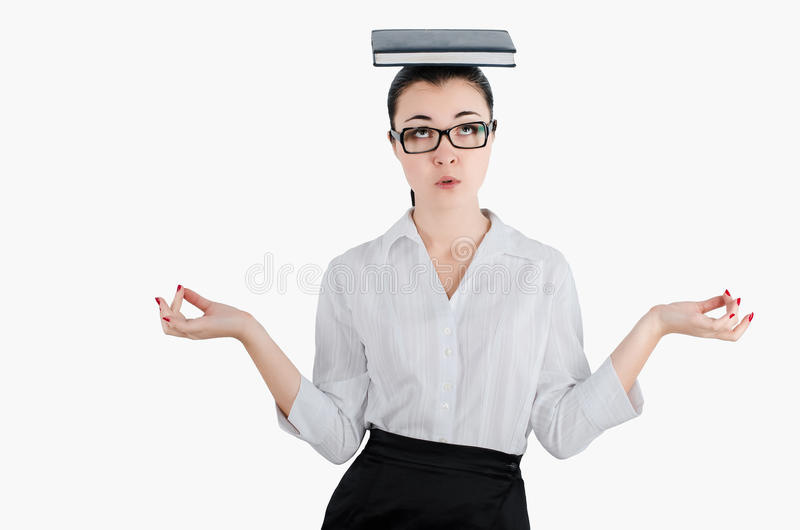 Tired, exhausted business woman holding a diary on his head with stock images